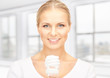 woman holding energy saving bulb