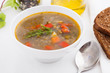 bowl of vegetable soup with brown bread