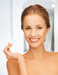 beautiful woman with moisturizing creme drop