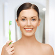 woman with toothbrush