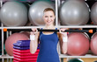 Athlete woman in sportswear working out with gymnastic stick