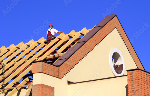 Carpenter man working on the new roof