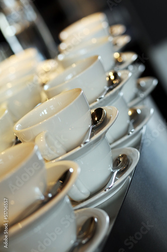 Coffee cups with spoons in a restaurant