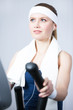 Athletic woman training on gym equipment in gym