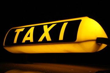 German Taxi sign at at night-time