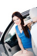 Close up of smiley woman in the car with door opened