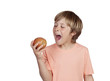 Preteen eating a red apple