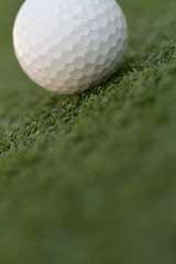 a golf ball in the distance on a putting green