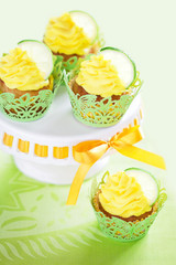 Lime cupcake with lemon cream, selective focus