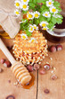 Waffles with honey and nuts on a wooden surface