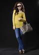 fashionable woman with handbag posing