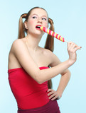 Young singing woman with lollipop