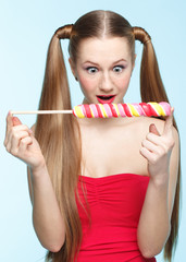 Young woman with lollipop
