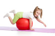 Kid having fun with  gymnastic ball isolated