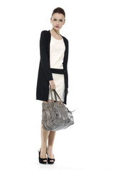 Full length of fashion model with big bag. Isolated