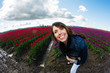 Pretty woman in field of tulips