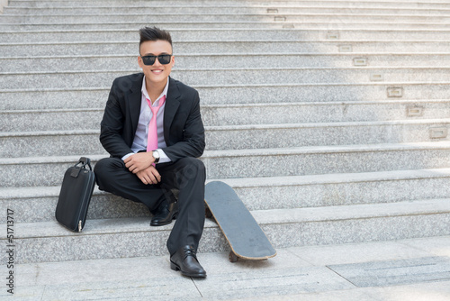 Manager with skateboard