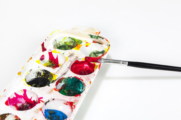 paint boxes with brushes