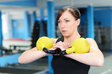 Young woman focused on exercise
