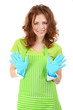 Young woman wearing green apron and rubber gloves, isolated