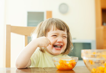 Happy  girl eating carrot salad