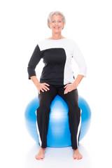 Senior woman gymnastic ball