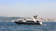 Luxury black yacht sails in Bosporus waters