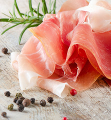 slices of ham and herbs