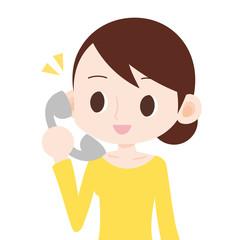 女性 上半身 受話器を持つ