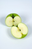 Green apple cut in half © Arena Photo UK
