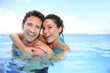 Quadro Couple having fun in swimming-pool