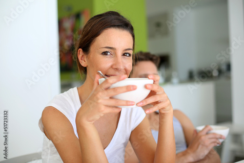 Portrait of young woman having breakfast