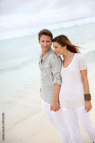 Romantic couple walking on the beach
