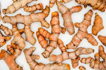 The turmeric roots on white background.