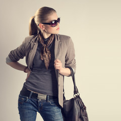Shopping woman. Attractive young fashion girl in sunglasses