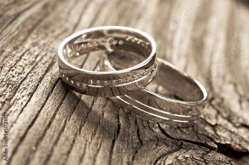 wedding rings on wood © poplasen