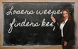 Постер, плакат: Teacher showing Losers weepers finders keepers on blackboard