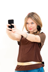 woman takes a picture with a phone