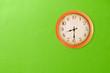 Leinwanddruck Bild - Clock showing 8:30 o'clock on a green wall