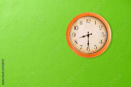 Leinwanddruck Bild Clock showing 8:30 o'clock on a green wall