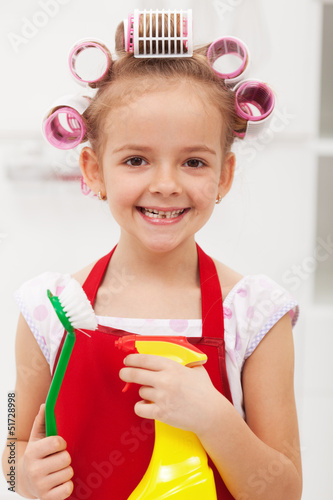 Little girl with cleaning utensils