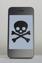 Mobile phone with skull and crossbones on the screen