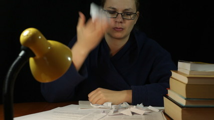 Unhappy woman crumpling paper