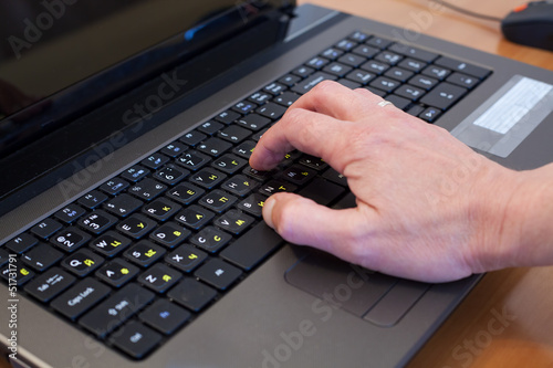 man's hand on a computer keyboard