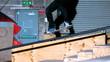 Skater doing crook slide down rail
