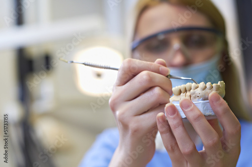 Dentist woman with teeth model