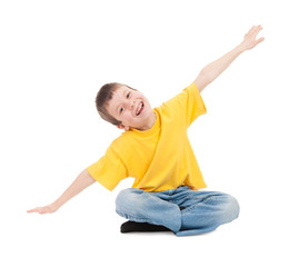 boy in yellow t-shirt simulates flight