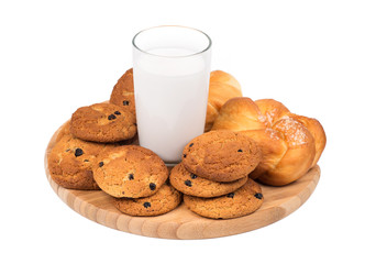 Milk and oatmeal cookies on a white background