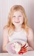 smile girl is eating healthy food