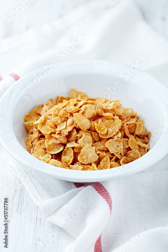 Corn flakes in a white bowl